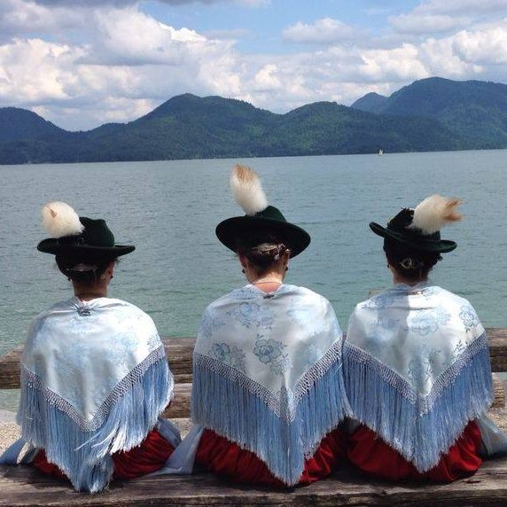 girls in traditional dresses at the walchensee